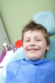Pediatric dentisty, boy in chair