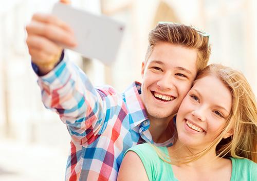 Couple taking a selfie, invisalign