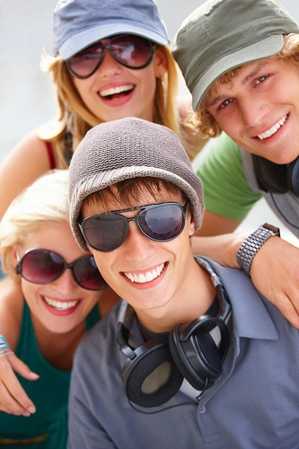 Four teens smiling