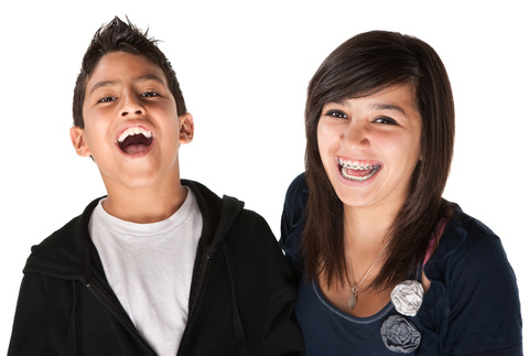 Two kids with orthodontics laughing