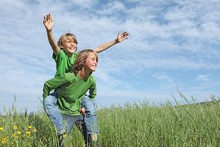 Children in grass field